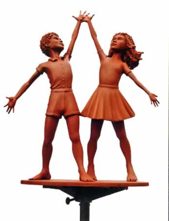 Sculpture of boy & girl